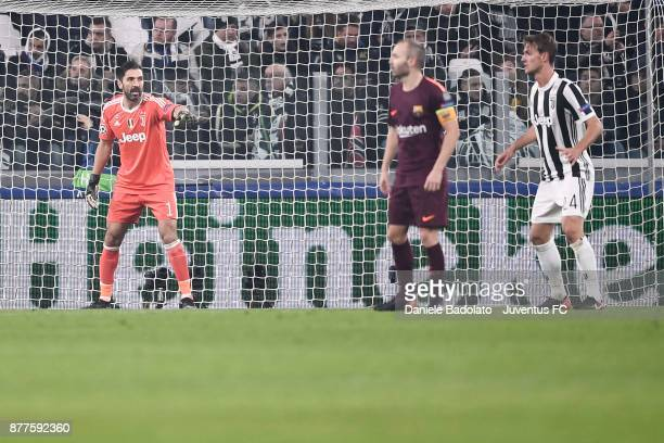 Gianluigi Buffon and Daniele Rugani of Juventus with Andrés Iniesta of Barcelona in action during the UEFA Champions League group D match between...