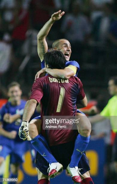 Gianluigi Buffon and Fabio Cannavaro of Italy celebrate Fabio Grosso's goal in extra time during the FIFA World Cup Germany 2006 Semifinal match...