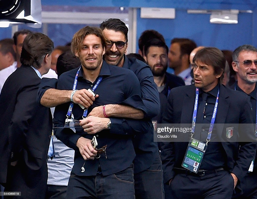 <a gi-track='captionPersonalityLinkClicked' href=/galleries/search?phrase=Gianluigi+Buffon&family=editorial&specificpeople=208860 ng-click='$event.stopPropagation()'>Gianluigi Buffon</a> (C) and <a gi-track='captionPersonalityLinkClicked' href=/galleries/search?phrase=Federico+Marchetti+-+Soccer+Player&family=editorial&specificpeople=15029741 ng-click='$event.stopPropagation()'>Federico Marchetti</a> joke during Italy pitch walkabout ahead of tomorrow's UEFA Euro 2016 quarter final match against Germany at Stade de Bordeaux on July 1, 2016 in Bordeaux, France.