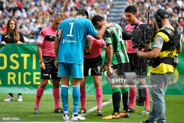 Gianluigi Buffon and Francesco Magnanelli during the Serie A match between US Sassuolo and Juventus at Mapei Stadium Citta' del Tricolore on...