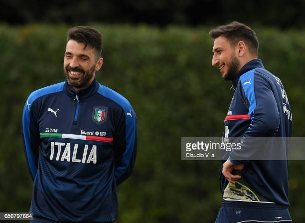 Gianluigi Buffon and Gianluigi Donnarumma of Italy chat during the training session at the club's training ground at Coverciano on March 23 2017 in...