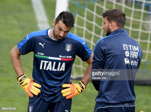 Gianluigi Buffon and Gianluigi Donnarumma of Italy chat during the training session at Coverciano on June 10 2017 in Florence Italy