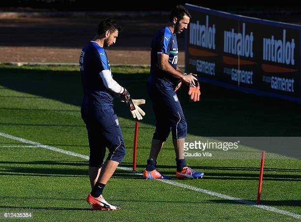 Gianluigi Buffon and Gianluigi Donnarumma of Italy in action during a training session at the club's training ground at Coverciano on October 4 2016...