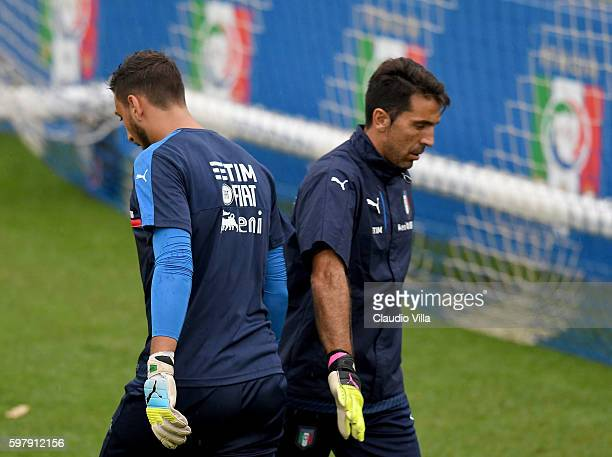 Gianluigi Buffon and Gianluigi Donnarumma of Italy in action during the training session at the club's training ground at Coverciano on August 30...