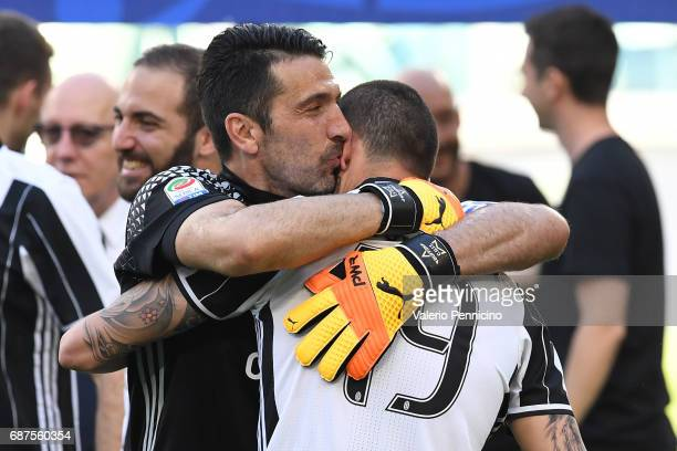 Gianluigi Buffon and Leonardo Bonucci of Juventus FC celebrate after the beating FC Crotone 30 to win the Serie A Championships at the end of the...