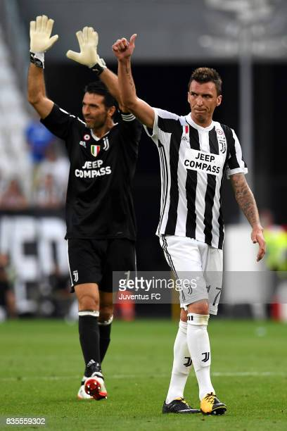 Gianluigi Buffon and Mario Mandzukic of Juventus celebrate after the Serie A match between Juventus and Cagliari Calcio at Allianz Stadium on August...