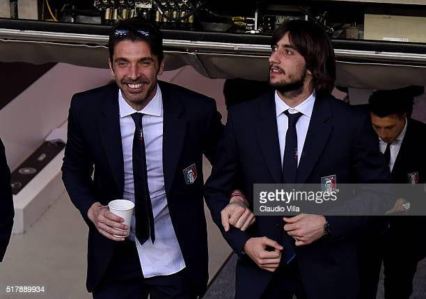 Gianluigi Buffon and Mattia Perin of Italy chat at the Allianz Arena on March 28 2016 in Munich Germany