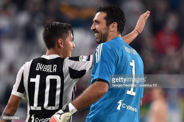Gianluigi Buffon and Paulo Dybala of Juventus celebrate the victory at the end of the Serie A match between Juventus and Torino FC on September 23...