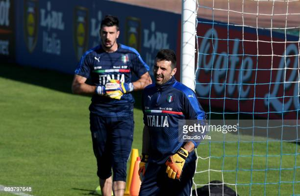 Gianluigi Buffon and Simone Scuffet of Italy look on during the training session at Coverciano on June 08 2017 in Florence Italy