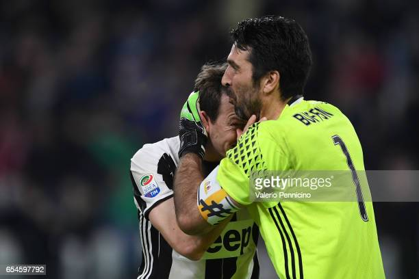 Gianluigi Buffon and Stephan Lichtsteiner of Juventus FC celebrate victory at the end of the Serie A match between Juventus FC and AC Milan at...
