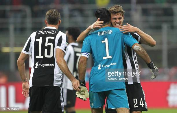Gianluigi Buffon Andrea Barzagli and Daniele Rugani of Juventus FC celebrate a victory at the end of the Serie A match between AC Milan and Juventus...
