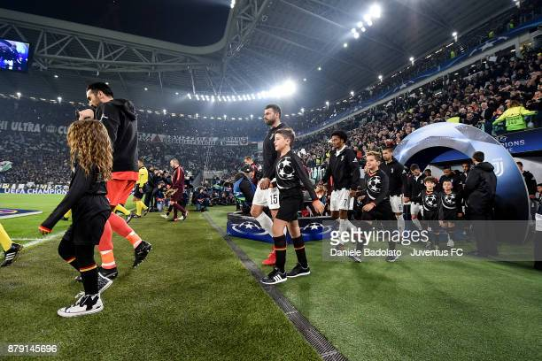 Gianluigi Buffon Andrea Barzagli and Juan Cuadrado during the UEFA Champions League group D match between Juventus and FC Barcelona at Allianz...
