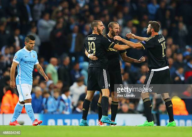 Gianluigi Buffon Andrea Barzagli of Juventus celebrate victory as Sergio Aguero of Manchester City looks dejected after the UEFA Champions League...