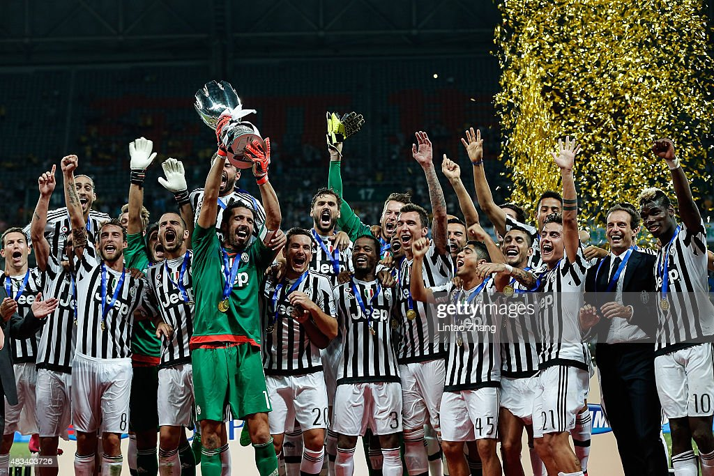 Gianluigi Buffon (C) captain of Juventus FC, celebrates with teammates after winning the Italian Super Cup final football match between Juventus and Lazio at Shanghai Stadium on August 8, 2015 in Shanghai, China.