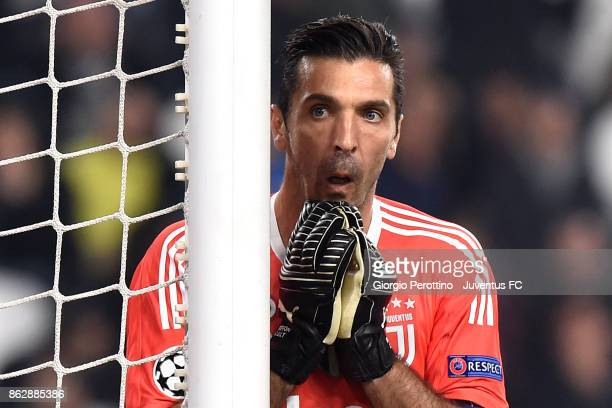 Gianluigi Buffon celebrates at the end of the UEFA Champions League group D match between Juventus and Sporting CP at Allianz Stadium on October 18...