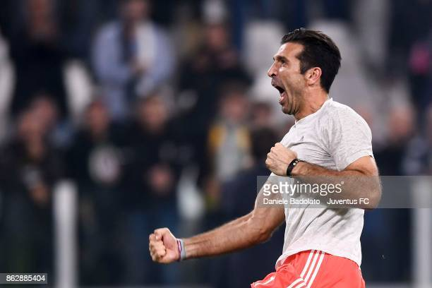Gianluigi Buffon celebrates the victory during the UEFA Champions League group D match between Juventus and Sporting CP at Allianz Stadium on October...