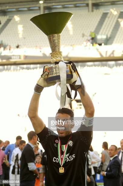Gianluigi Buffon celebrates the victory of the Italian championship 2016/17 after the Serie A football match between Juventus FC and FC Crotone at...