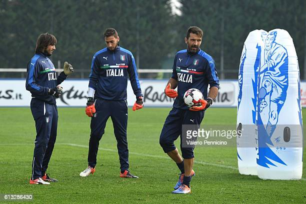 Gianluigi Buffon Gianluigi Donnarumma and Mattia Perin of Italy warm up during an Italy training session at Juventus Center Vinovo on October 8 2016...