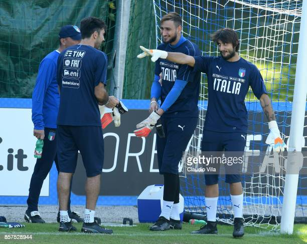 Gianluigi Buffon Gianluigi Donnarumma of Italy and Mattia Perin chat during a training session at Italy club's training ground at Coverciano on...