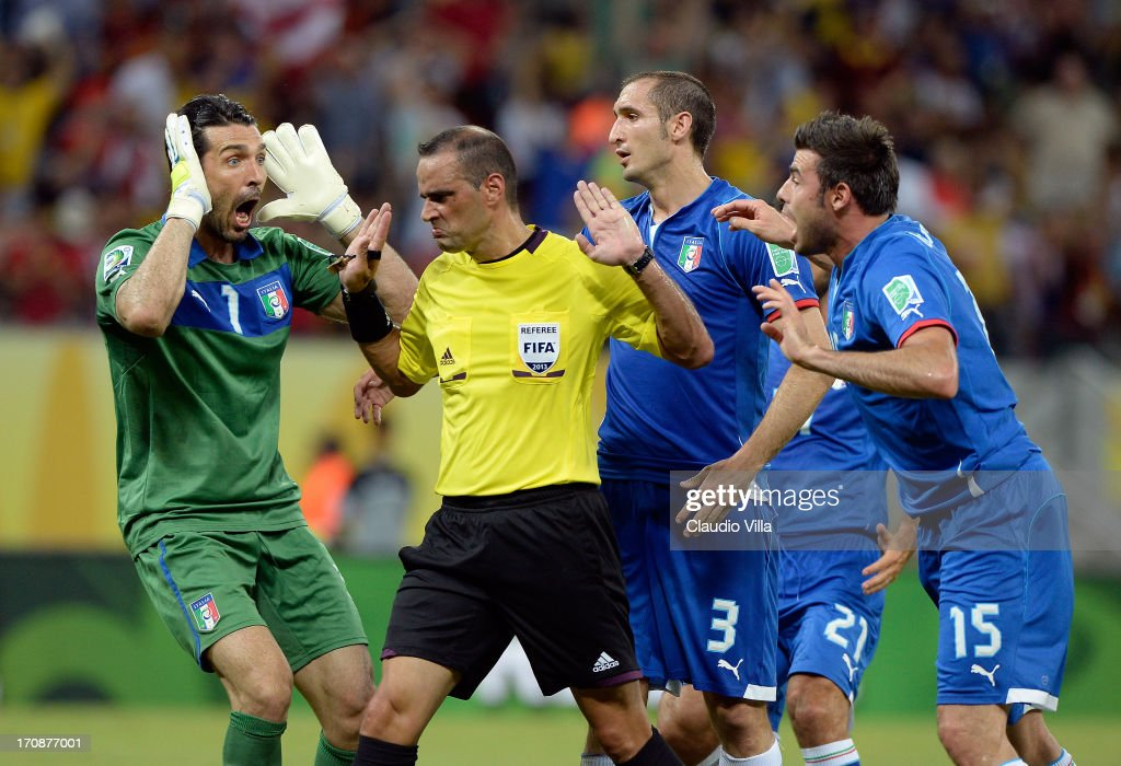 <a gi-track='captionPersonalityLinkClicked' href=/galleries/search?phrase=Gianluigi+Buffon&family=editorial&specificpeople=208860 ng-click='$event.stopPropagation()'>Gianluigi Buffon</a> (L) Giorgio Chiellini and <a gi-track='captionPersonalityLinkClicked' href=/galleries/search?phrase=Andrea+Barzagli&family=editorial&specificpeople=465353 ng-click='$event.stopPropagation()'>Andrea Barzagli</a> (R) Italy protest to Referee Diego Abal after Japan were awarded a penalty during the FIFA Confederations Cup Brazil 2013 Group A match between Italy and Japan at Arena Pernambuco on June 19, 2013 in Recife, Brazil.