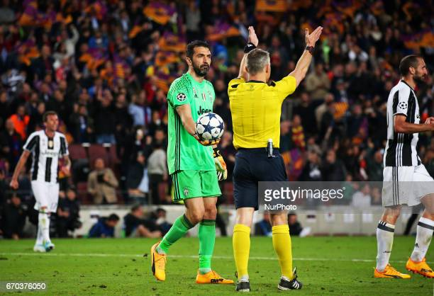 Gianluigi Buffon gives the ball to the referee Bjorn Kuipers at the end of the UEFA Champions League match between FC Barcelona v PSG in Barcelona on...