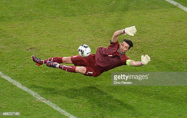 Gianluigi Buffon goalkeeper of Italty saves a shot from Wayn Rooney of England during the international friendly match between Italy and England at...