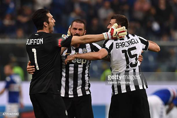 Gianluigi Buffon Leonardo Bonucci and Andrea Barzagli of Juventus FC celebrate after beating UC Sampdoria 10 to win the Serie A Championships at the...