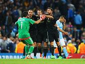 Gianluigi Buffon Leonardo Bonucci Giorgio Chiellini and Andrea Barzagli of Juventus celebrate victory as Sergio Aguero of Manchester City look...