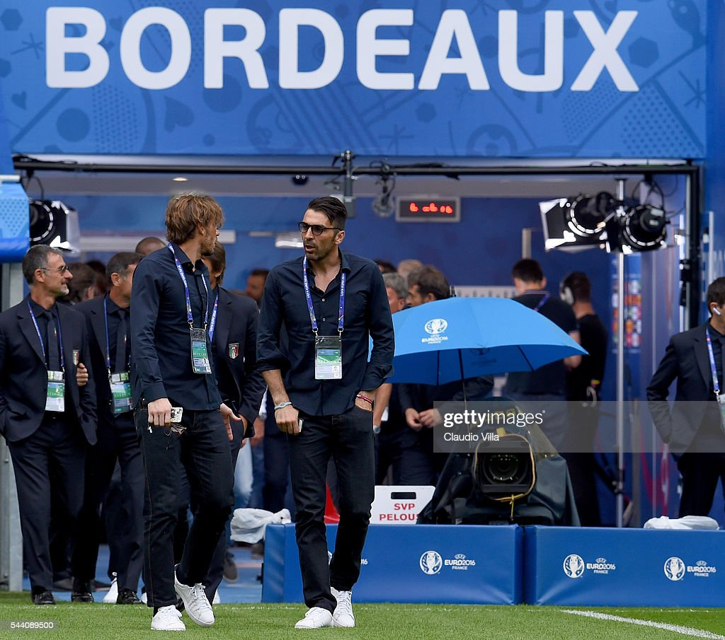 <a gi-track='captionPersonalityLinkClicked' href=/galleries/search?phrase=Gianluigi+Buffon&family=editorial&specificpeople=208860 ng-click='$event.stopPropagation()'>Gianluigi Buffon</a> (R) looks on during Italy pitch walkabout ahead of tomorrow's UEFA Euro 2016 quarter final match against Germany at Stade de Bordeaux on July 1, 2016 in Bordeaux, France.