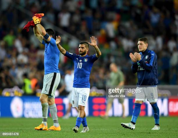Gianluigi Buffon Lorenzo Insigne and Andrea Belotti of Italy celebrate at the end of the FIFA 2018 World Cup Qualifier between Italy and...