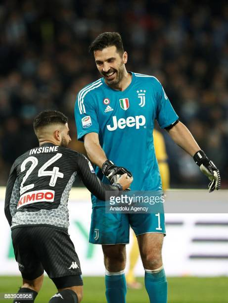 Gianluigi Buffon of FC Juventus helps Lorenzo Insigne of SSC Napoli during the Serie A football match between SSC Napoli and FC Juventus at the San...