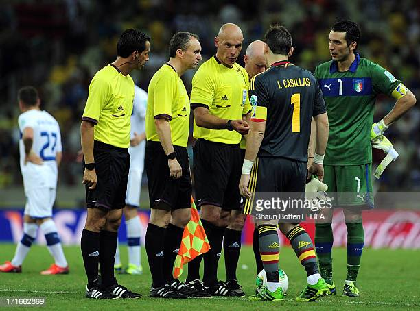 Gianluigi Buffon of Italy and Iker Casillas of Spain speak to Referee Howard Webb before the start of extratime during the FIFA Confederations Cup...