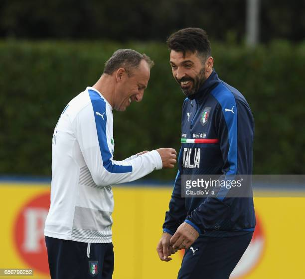 Gianluigi Buffon of Italy and Italy goalkeeper coach Gianluca Spinelli chat during the training session at the club's training ground at Coverciano...