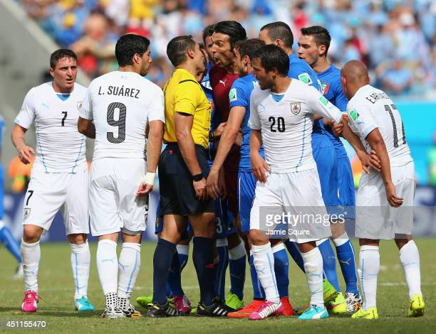 Gianluigi Buffon of Italy appeals to referee Marco Rodriguez after Claudio Marchisio is sent off during the 2014 FIFA World Cup Brazil Group D match...