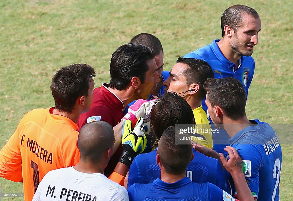 <a gi-track='captionPersonalityLinkClicked' href=/galleries/search?phrase=Gianluigi+Buffon&family=editorial&specificpeople=208860 ng-click='$event.stopPropagation()'>Gianluigi Buffon</a> of Italy appeals to referee <a gi-track='captionPersonalityLinkClicked' href=/galleries/search?phrase=Marco+Rodriguez+-+Referee&family=editorial&specificpeople=12960306 ng-click='$event.stopPropagation()'>Marco Rodriguez</a> after <a gi-track='captionPersonalityLinkClicked' href=/galleries/search?phrase=Claudio+Marchisio&family=editorial&specificpeople=4604252 ng-click='$event.stopPropagation()'>Claudio Marchisio</a> is sent off during the 2014 FIFA World Cup Brazil Group D match between Italy and Uruguay at Estadio das Dunas on June 24, 2014 in Natal, Brazil.