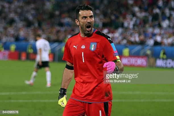 Gianluigi Buffon of Italy celebrates after saving the penalty of Thomas Muller of Germany during the shoot out following the UEFA Euro 2016 Quarter...