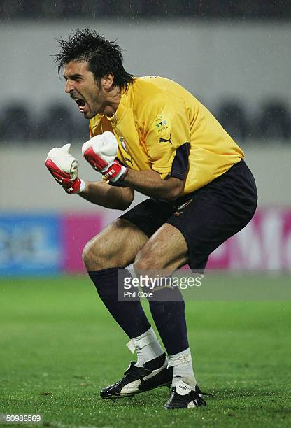 Gianluigi Buffon of Italy celebrates their first goal during the UEFA Euro 2004 Group C match between Italy and Bulgaria at the Estadio D Afonso...