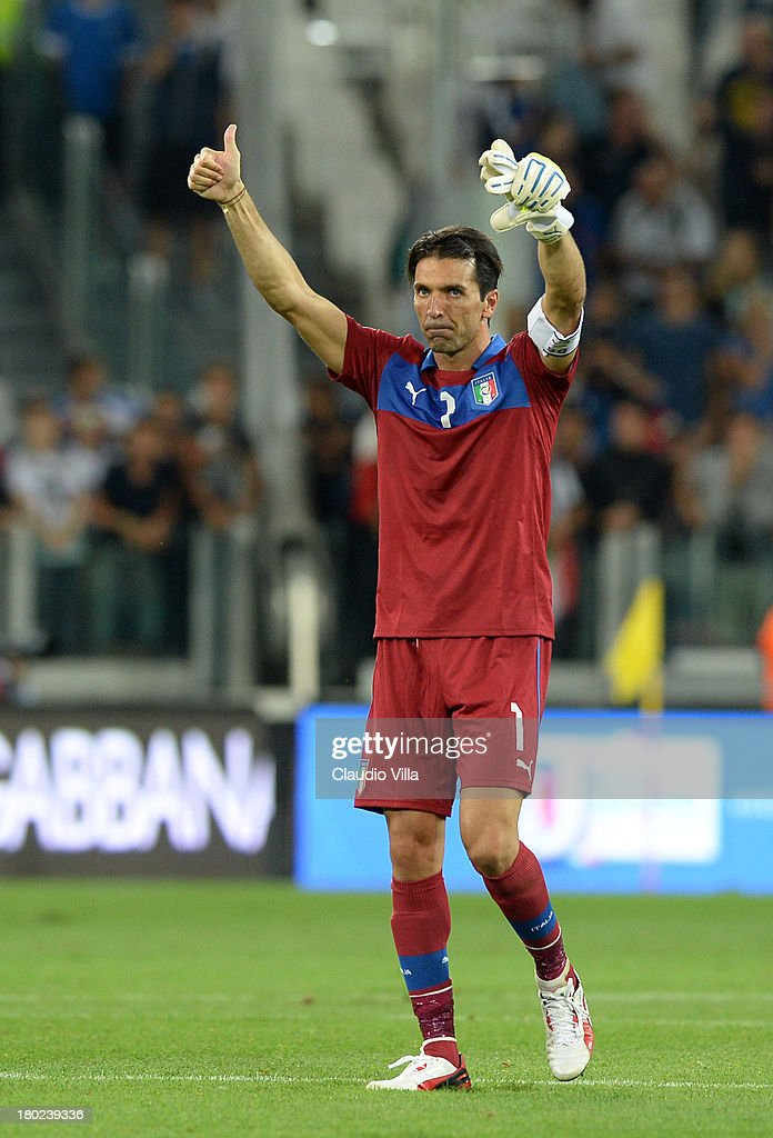 <a gi-track='captionPersonalityLinkClicked' href=/galleries/search?phrase=Gianluigi+Buffon&family=editorial&specificpeople=208860 ng-click='$event.stopPropagation()'>Gianluigi Buffon</a> of Italy celebrates victory at the end of the the FIFA 2014 World Cup Qualifier group B match between Italy and Czech Republic at Juventus Arena on September 10, 2013 in Turin, Italy.