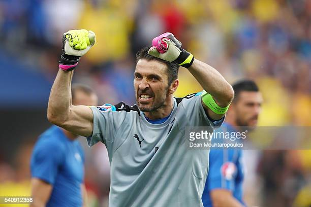 Gianluigi Buffon of Italy celebrates victory in the UEFA EURO 2016 Group E match between Italy and Sweden at Stadium Municipal on June 17 2016 in...