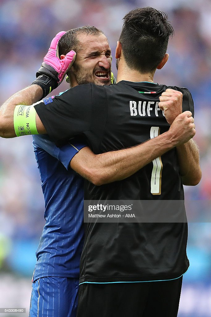 <a gi-track='captionPersonalityLinkClicked' href=/galleries/search?phrase=Gianluigi+Buffon&family=editorial&specificpeople=208860 ng-click='$event.stopPropagation()'>Gianluigi Buffon</a> of Italy celebrates with <a gi-track='captionPersonalityLinkClicked' href=/galleries/search?phrase=Giorgio+Chiellini&family=editorial&specificpeople=605793 ng-click='$event.stopPropagation()'>Giorgio Chiellini</a> at the end of the UEFA Euro 2016 Round of 16 match between Italy and Spain at Stade de France on June 27, 2016 in Paris, France.