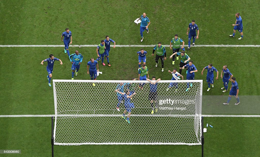<a gi-track='captionPersonalityLinkClicked' href=/galleries/search?phrase=Gianluigi+Buffon&family=editorial&specificpeople=208860 ng-click='$event.stopPropagation()'>Gianluigi Buffon</a> of Italy clings on the crossbar to celebrates his team's 2-0 win in the UEFA EURO 2016 round of 16 match between Italy and Spain at Stade de France on June 27, 2016 in Paris, France.