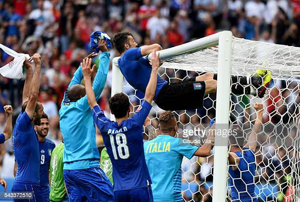 Gianluigi Buffon of Italy clings on the crossbar to celebrates his team's 20 win in the UEFA EURO 2016 round of 16 match between Italy and Spain at...