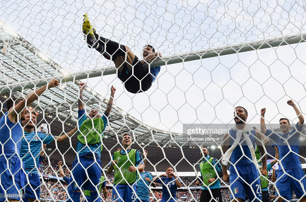 Gianluigi Buffon of Italy clings on the crossbar to celebrates his team's 2-0 win in the UEFA EURO 2016 round of 16 match between Italy and Spain at Stade de France on June 27, 2016 in Paris, France.