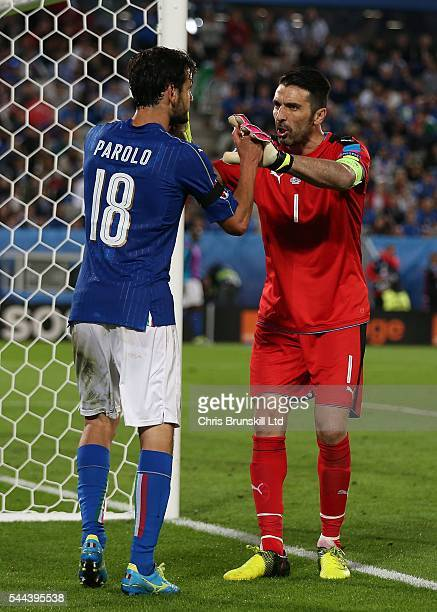 Gianluigi Buffon of Italy congratulates teammate Marco Parolo during the UEFA Euro 2016 Quarter Final match between Germany and Italy at Nouveau...