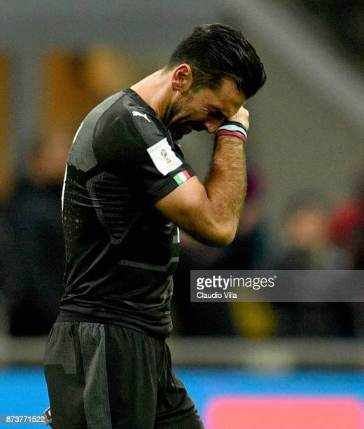 Gianluigi Buffon of Italy dejected at the end of the FIFA 2018 World Cup Qualifier PlayOff Second Leg between Italy and Sweden at San Siro Stadium on...