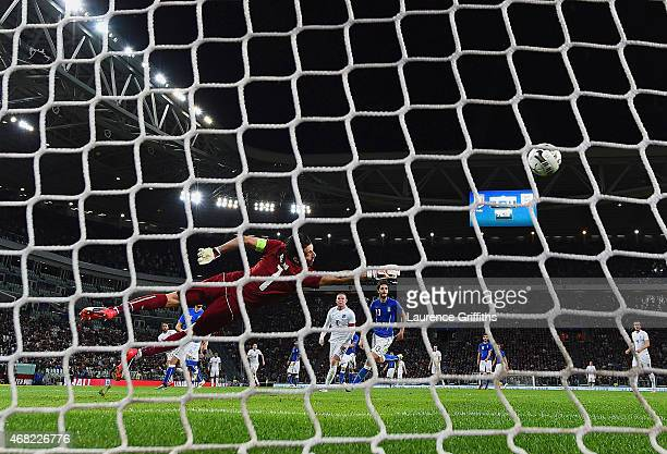 Gianluigi Buffon of Italy dives in vain as Andros Townsend of England scores their first goal during the international friendly match between Italy...