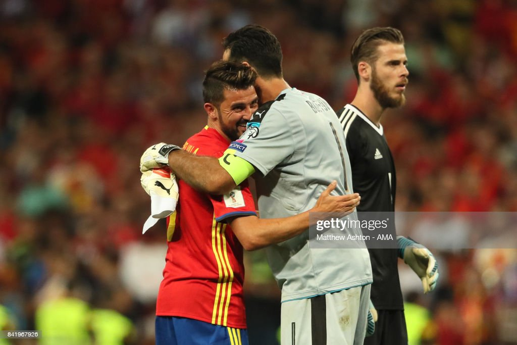 Gianluigi Buffon of Italy embraces David Villa of Spain at the end of the FIFA 2018 World Cup Qualifier between Spain and Italy at Estadio Santiago Bernabeu on September 2, 2017 in Madrid, Spain.