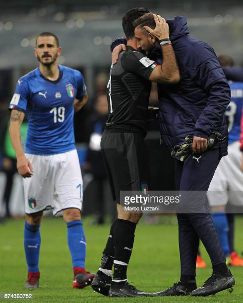 Gianluigi Buffon of Italy embraces Gianluigi Donnarumma at the end of the FIFA 2018 World Cup Qualifier PlayOff Second Leg between Italy and Sweden...