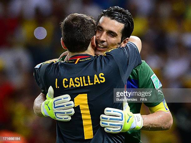 Gianluigi Buffon of Italy embraces Iker Casillas of Spain at the end of a penalty shootout during the FIFA Confederations Cup Brazil 2013 Semi Final...