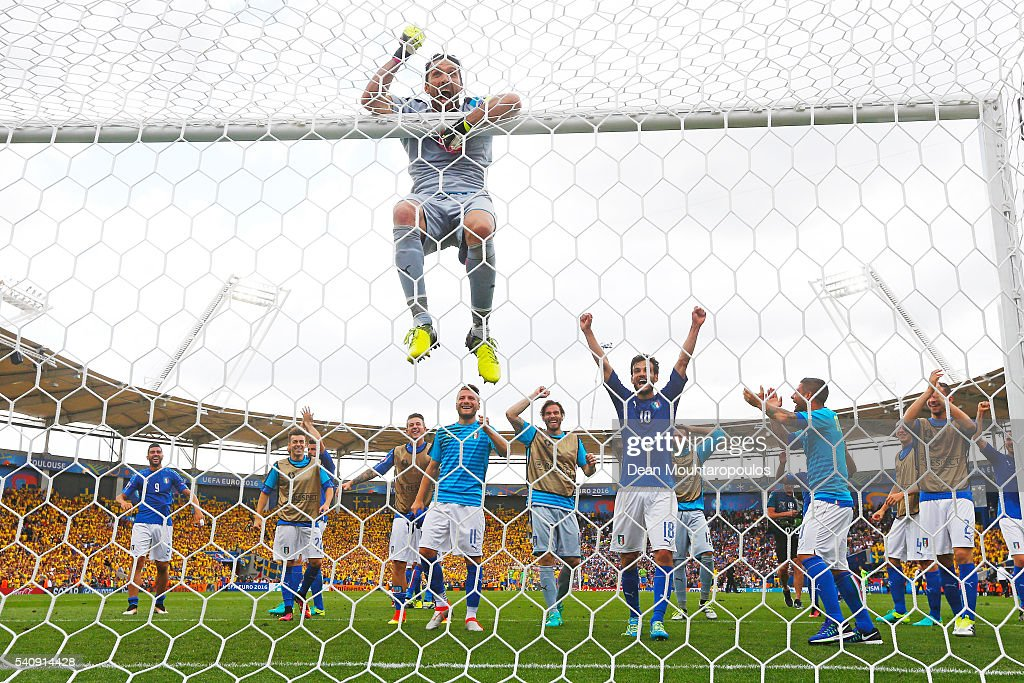 Gianluigi Buffon of Italy hangs from the crossbar as the Italian team celebrate victory in the UEFA EURO 2016 Group E match between Italy and Sweden at Stadium Municipal on June 17, 2016 in Toulouse, France.